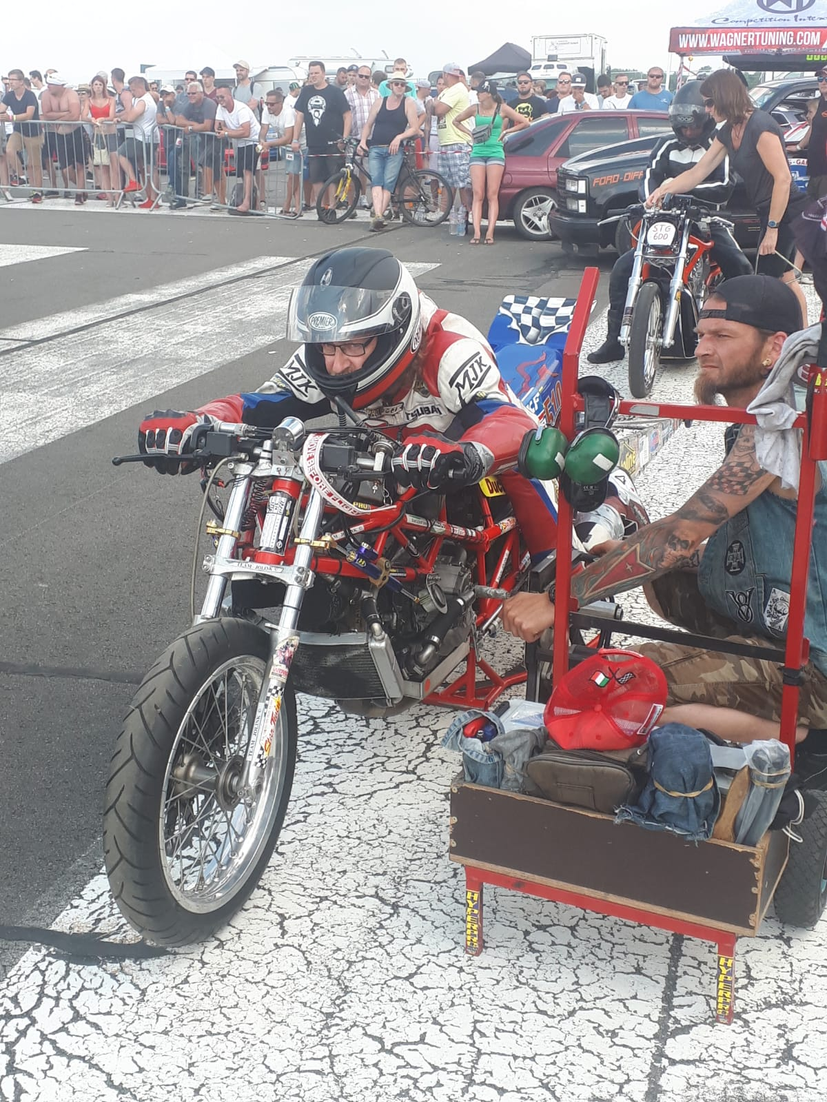 8-10 june 2018 European Super twin Top Gas Drag Race Alkersleben Germany Crew Chief Kralle Viehrig (Chemnitz Germany) starting up the Ducati 1198 RS Drag Bike. WE Qualified 5th from the 12 Top Gas riders, the track have not good grip. We did on the 1/8 Mile (201 m) 5.860 sec with 201 kmh with 5th gears, 60 foot (18 m) 1.459 (on a good track we do 1.2 on the 60 ft). Eleminations 1/8 Final Herman Jolink did 5.941 sec with 201 kmh def. Andreas Herr Germany on V-Twin 7.403-130 (Qualified with 6.399-174 kmh) Herr waiting ferry long to go in stage Jolink go then first in stage(wen you wait to long you get a red light) 1/4 final Olaf Menzi CH on 2622 Prostock V-Twin 5.396-216 kmh def Herman Jolink 5.864-201 kmh Rek Jolink 0.166 Menzi 0.288 Jolink ridng ferry konstant runs from 5.8 seconds Top Gas Championship after two rounds Jolink NL on the 4th Place with 520 points 1st Lymant De 1370 points last 15th Severa Czech Republic