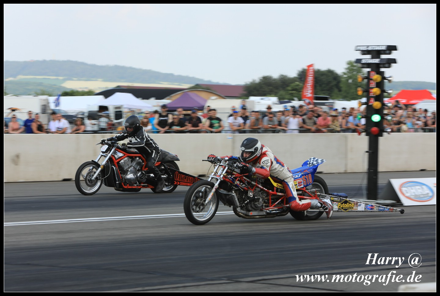 8-10 jun 2018 Alkersleben Germany 2nd Super Twin Top Gas round, left lane Herm,an Jolink on the Ducati 1198 RS Drag Bike fighting to get not cross midlle line leaning with his body to the left, right lane Petersen Germany on 1300 V-Rod Destroyer
